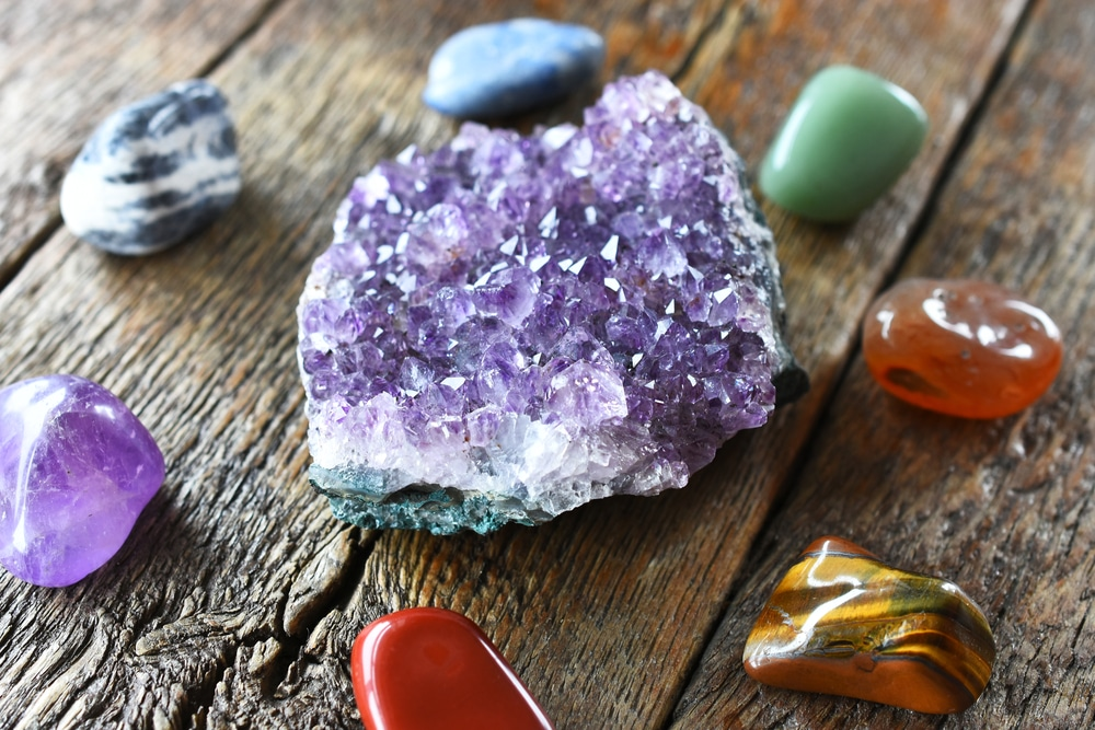 Chakra crystals and amethyst geode cluster