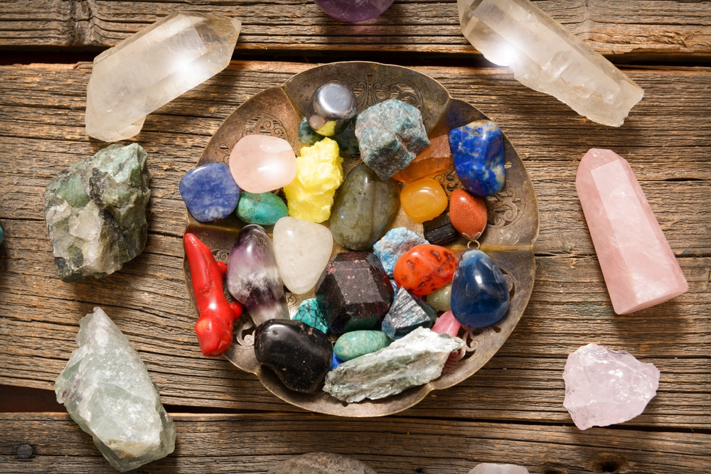 Various healing crystals on wooden board - rose quartz